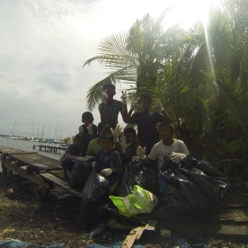 Children of Careneros helping clean up